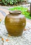 Baked clay jar at  rock Royalty Free Stock Image