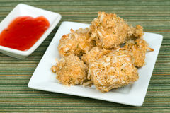 Baked coconut chicken with sweet and sour sauce Stock Images