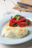 Baked cod fillet with salad Stock Photos