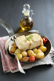 Baked cod fish with potatoes and vegetables Royalty Free Stock Image