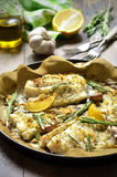 Baked cod with ginger,lemon and rosemary. royalty free stock photos