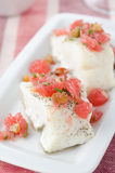 Baked cod with grapefruit salsa selective focus Stock Photo