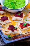 The baked cod with green pea Royalty Free Stock Image