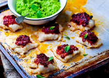 The baked cod with green pea Royalty Free Stock Photos