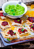 The baked cod with green pea Royalty Free Stock Images