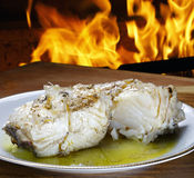 Baked cod with olive oil Royalty Free Stock Photography