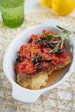 Baked cod under tomato sauce Stock Photo