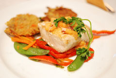 Baked cod with vegetables Stock Photos
