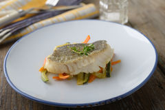 Baked cod with vegetables Stock Image