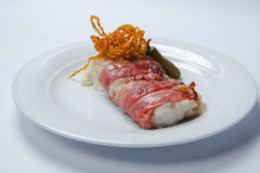 Baked cod wrapped in bacon and mashed poatoes Royalty Free Stock Images