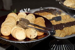 Baked Cookies Buffet. All kinds of delicious baked cookies served up on buffet platters Stock Photos