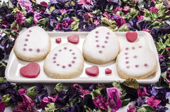 Baked cookies with frosting and pink pearls Royalty Free Stock Photos