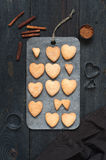 Baked cookies-hearts and kitchen utensils. On the vintage wooden table Royalty Free Stock Photography