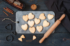 Baked cookies-hearts on the wooden table. Baked cookies-hearts on the vintage wooden table Stock Images