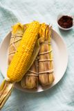 Baked corn with chili sauce stock photos