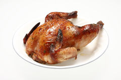 Baked Cornish game hen Stock Photo