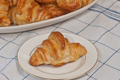 Baked croissant on a plate Stock Photos