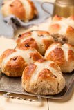 Baked cross buns on a metal tray royalty free stock image