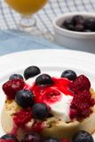 Breakfast crumpets. A baked crumpet with yoghurt and fresh fruits and orange juice for breakfast Royalty Free Stock Image