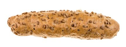 Wholegrain bread roll sprinkled with sunflower seeds Stock Photography