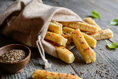Baked cumin sticks. Baked salty breadsticks sprinkled with cumin seeds Stock Image