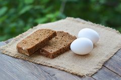 The baked cut rye bread and eggs Royalty Free Stock Photography