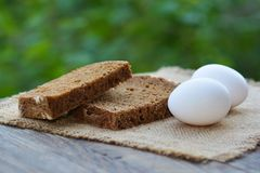 The baked cut rye bread and eggs Stock Images