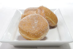 Baked donut with sugar on a plate Stock Photo