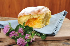 Baked donut / yeast with apricot jam Royalty Free Stock Photography