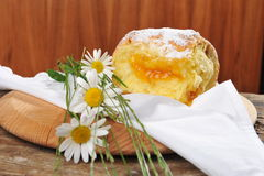 Baked donut / yeast with apricot jam Royalty Free Stock Photos