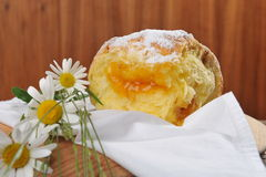 Baked donut / yeast with apricot jam Royalty Free Stock Photo