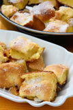 Baked dough with powdered sugar Royalty Free Stock Images