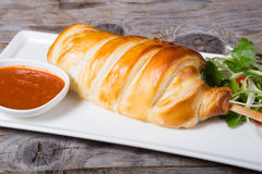 Baked dough stuffed with meat and fish Stock Photos