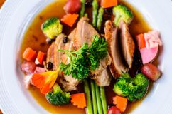 baked duck with coffee and vegetable,roasted duck stock images