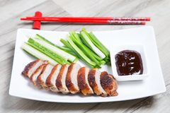 Baked duck with hoisin sauce, cucumbers and shallots. Selective focus, close-up stock photography