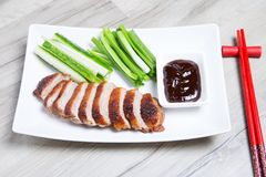 Baked duck with hoisin sauce, cucumbers and shallots. Selective focus, close-up royalty free stock photos