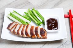 Baked duck with hoisin sauce, cucumbers and shallots. Selective focus, close-up royalty free stock photo
