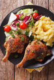 Baked duck leg, mashed potatoes and fresh salad mix close-up. ve Royalty Free Stock Photos