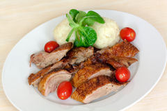 Baked Duck Slices with Dumplings,Cherry Tomatoes,G Royalty Free Stock Photos