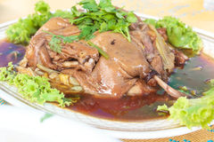 Baked duck stuffed with chinese flowers. Stock Images