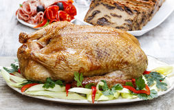 Baked duck on wooden table Royalty Free Stock Image