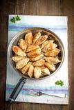 Baked dumplings on a cast-iron frying pan stock photos