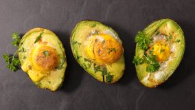 Baked egg in avocado. Top view Royalty Free Stock Images