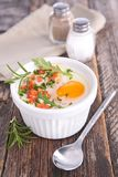 Baked egg and cream. On wood stock photography