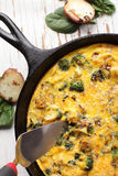 Baked egg frittata with slice top view Stock Photography