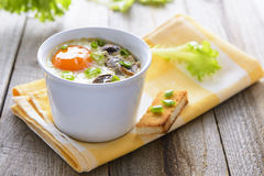 Baked egg with mashrooms and toast Royalty Free Stock Images