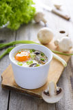 Baked egg with mushrooms and chive Royalty Free Stock Photo