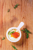 Baked egg with red caviar Stock Photos