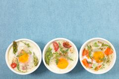 Baked egg and rocket. Top view Stock Images