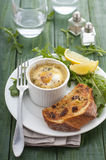 Baked egg with salad and bread Royalty Free Stock Photos